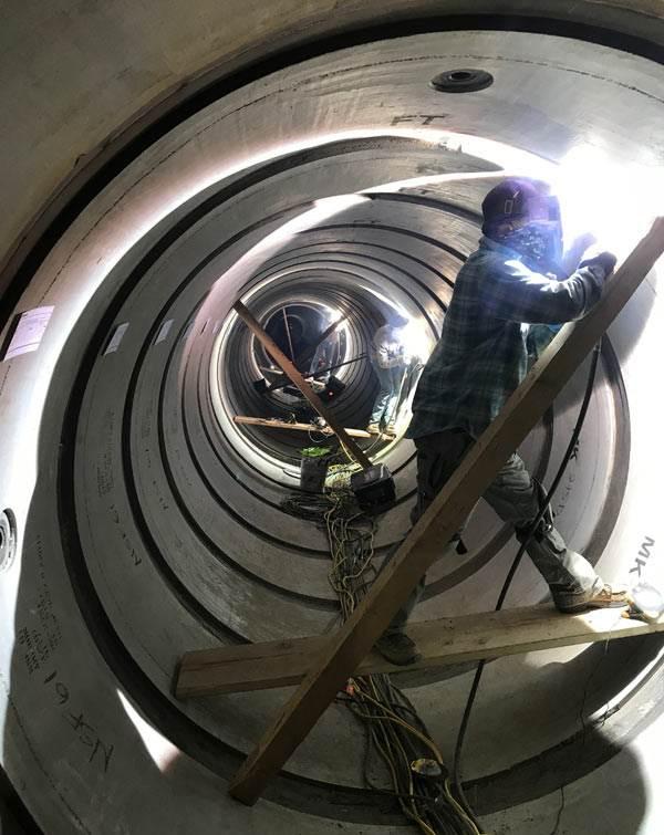 man-inside-pipe